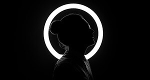 Woman silhouetted with white ring light for CareerArc 2017 Future of Recruiting Study